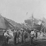 Photograph of people viewing train collision wreckage, Madison County, Georgia, 1910